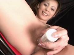 Sexy Natsumi pokes a vibrator around her snatch